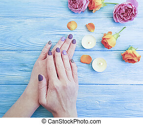 flower rose, candle on wooden background