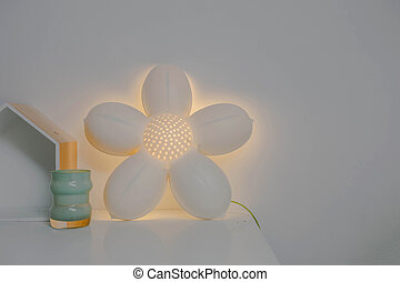 Flower shape lamp on white wall modern design, girly style