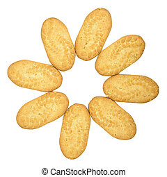 Flower shape made of biscuits on white background