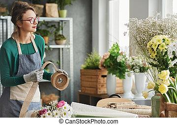 Flower shop owner making a bouquet