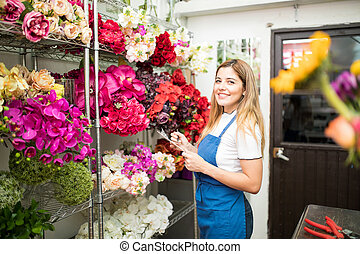 Flower shop owner with a checklist
