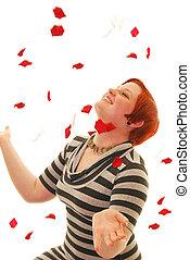 Flower shower - Attractive Caucasian woman being showered...