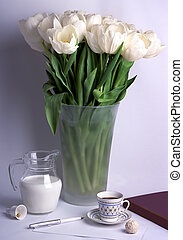 Flower still life. A large bouquet of white tulips in a vase