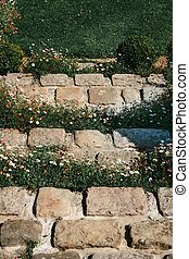 Flower stone staircase in front of the entrance door