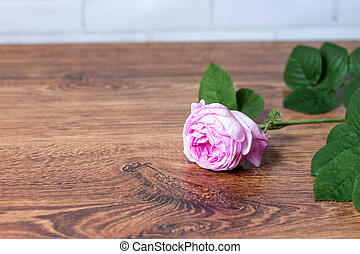 Flower tea rose buds on old wooden table