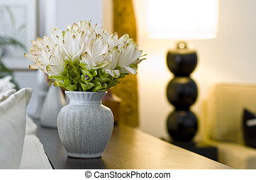 Flower vase in beautiful interior design decoration with shallow depth of field