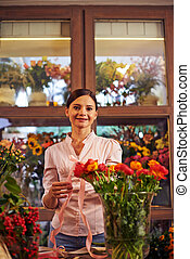 Flower vendor - Portrait of a woman at flower shop