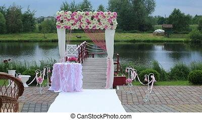 Flower wedding arch near the lake