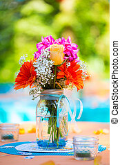 Flowers make up this wedding reception table centerpiece.