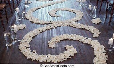 Flower white rose petals on wedding ceremony