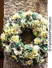 Flower wreath on the wall of an old house in Salzburg