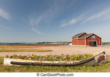 North Rustico, Prince Edward Island - Flowerbed and building...