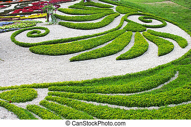 Flowerbed - Abstract shapes from a green grass