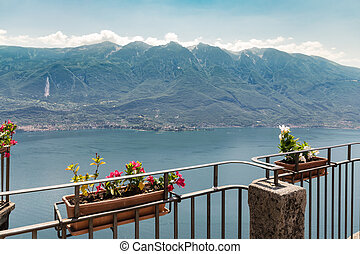 Flowered terrace overlooking Lake Garda. - Flowered terrace...