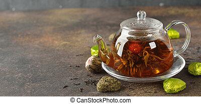 Flowering tea in a glass teapot