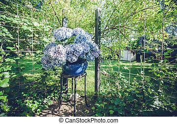 Flowerpot on a garden terrace