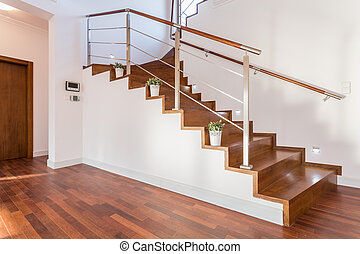Flowerpots situated on wooden stairs