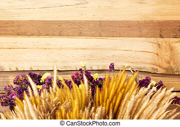 Flowers against brown wood background