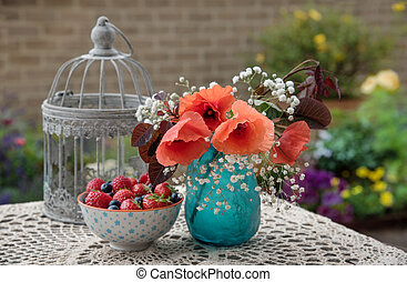Flowers and berries on the table