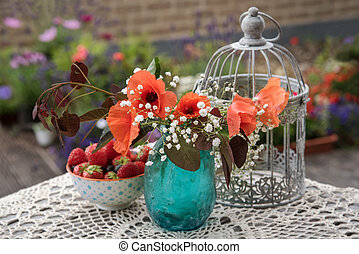 Flowers and berries outdoor table decor