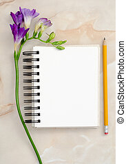 Flowers and blank notepad
