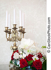 Flowers and candlestick - On the table is a candlestick, in...