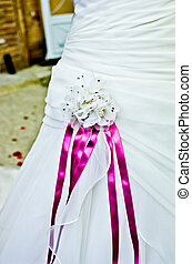 flowers and colored ribbons of the wedding dress