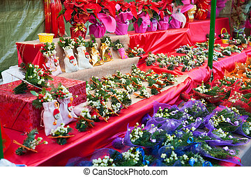 Flowers and decorations for sale at the Christmas market