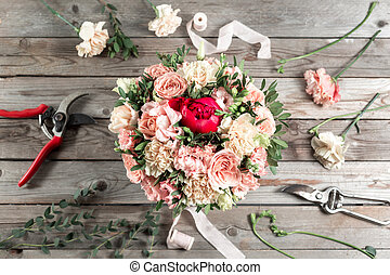 flowers and garden tools. The florist work table with...