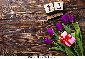 Flowers and gift box. Mothers day concept