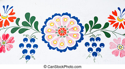 Flowers and grapes: closeup of traditional colorful folk...
