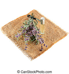 Flowers and lavender oil isolated on white background.