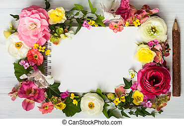 Flowers and notepad - Blank notepad, pen and flowers over ...