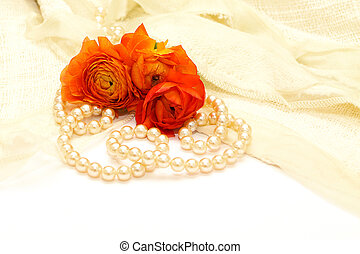 flowers and pearls on the background of delicate lace