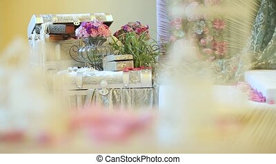 Flowers and trunk and candlesticks. Dynamic change of focus....