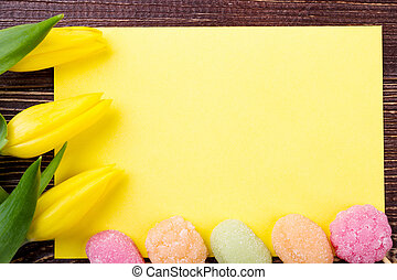 Flowers and yellow blank paper.