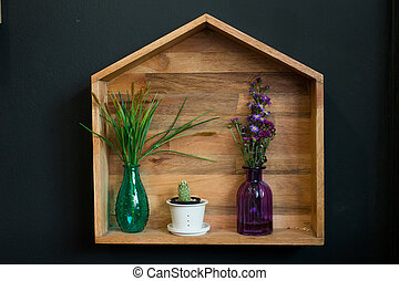 flowers arranged in the corner of a wooden box