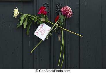 flowers at french consulate - flowers at the door handle of...