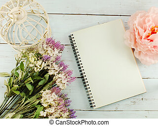 flowers bouquet and blank photo frame with copy space background