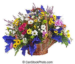 Flowers bouquet arrangement centerpiece in wicker basket isolated on white background. Closeup.