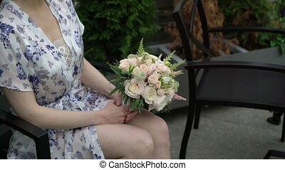 Flowers bouquet in woman hands shot