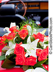 Flower's bouquet on a red car - Flower's bouquet on a...