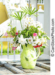Flowers bouquet on wood table