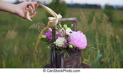Flowers composition in crate. At the heart of peony, the...