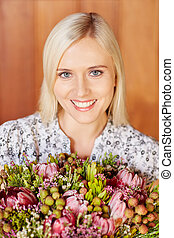 Flowers for me - Portrait of a beautiful young woman holding...