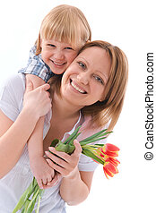 flowers for mom - young boy bringing a bunch of flower to...