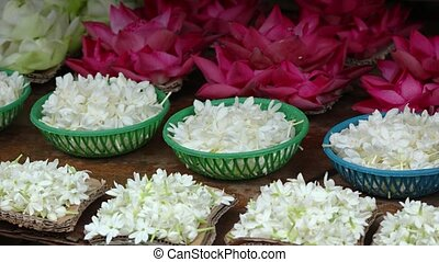 Flowers for religious ceremonies are sold on the market. Sri Lanka, Candy. Video 6k resolution