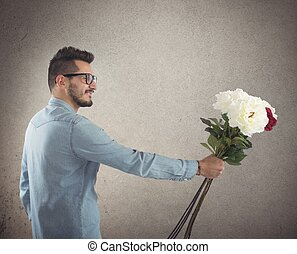 Flowers gift - Nerd boy gives flowers to a girl