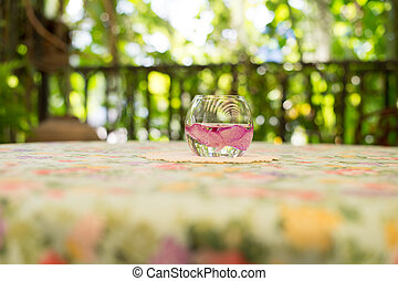 Flowers in a glass on the table