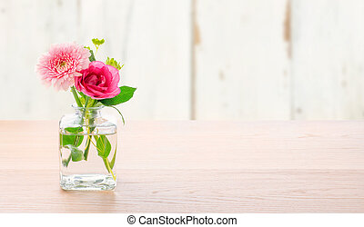 Flowers in a glass vase with copy space